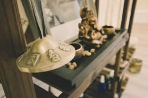 chime bells and statues from yoga alter in shambhala yoga studio