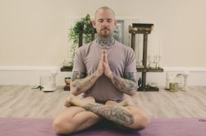 picture of Kyle in meditation on yoga mat
