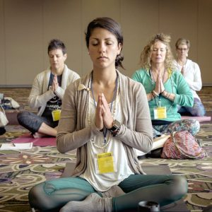 yoga class students seated in meditation